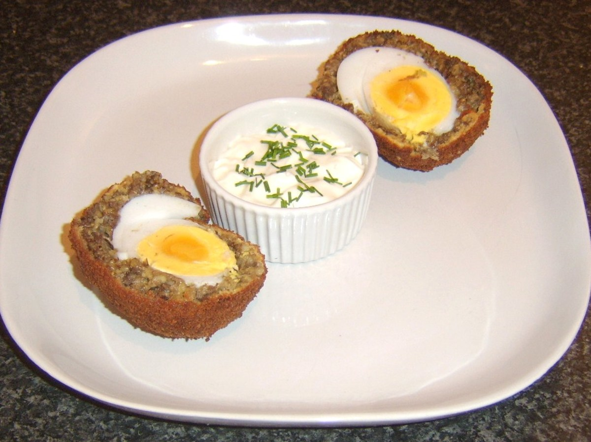 Haggis Scotch duck egg is plated with dip