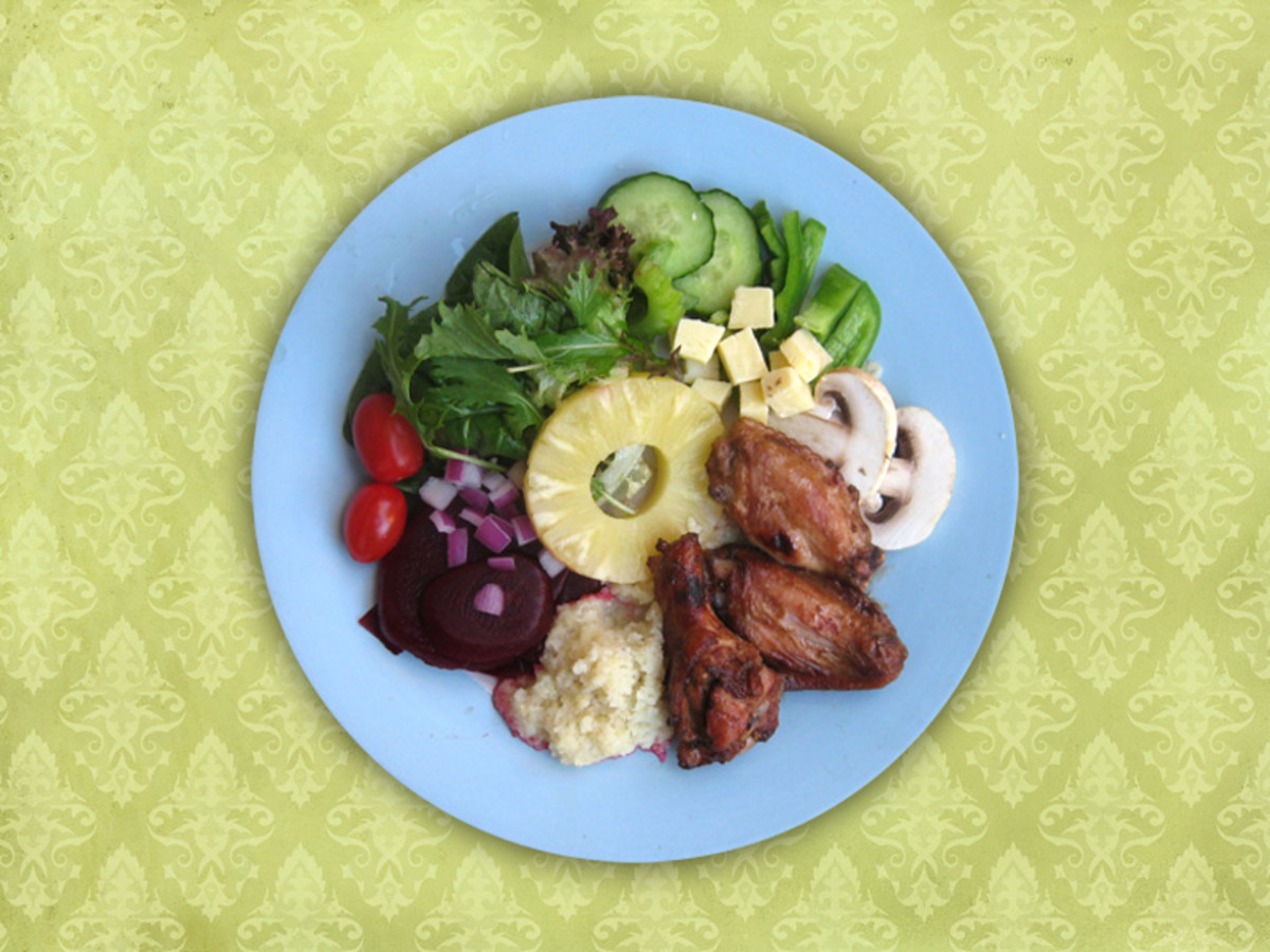 Grilled chicken wings with salad make for a nice, easy summer meal.