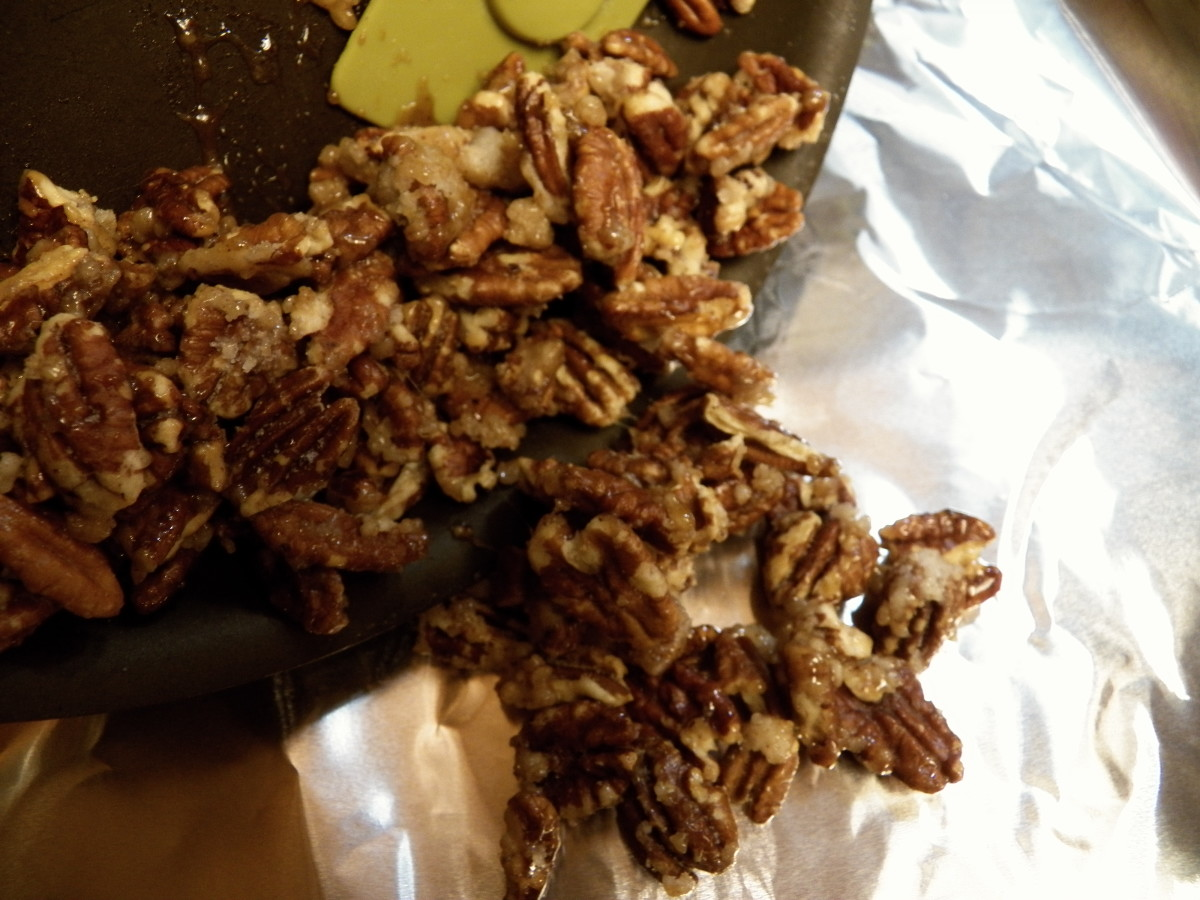 Pour pecans onto foil, parchment paper or silicone sheet to cool,