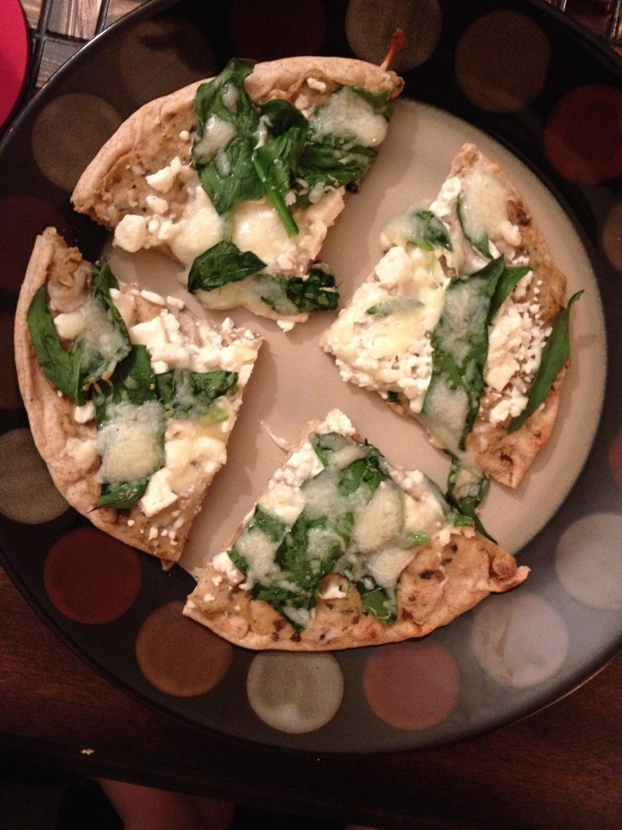 This is another version of the pizza. It has black olive hummus, spinach, the leftover feta, and some Italian cheeses on top.