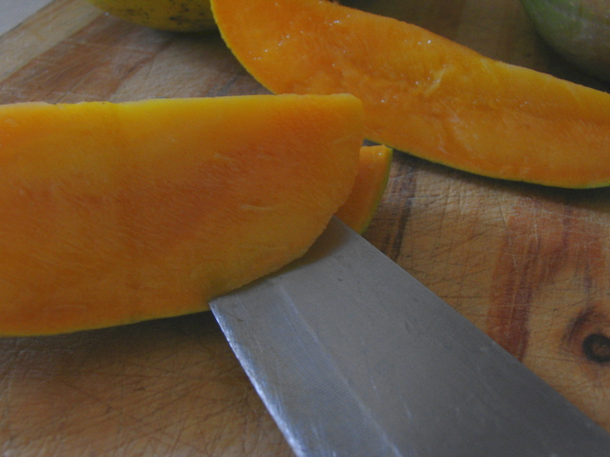 Removing the skin of a mango