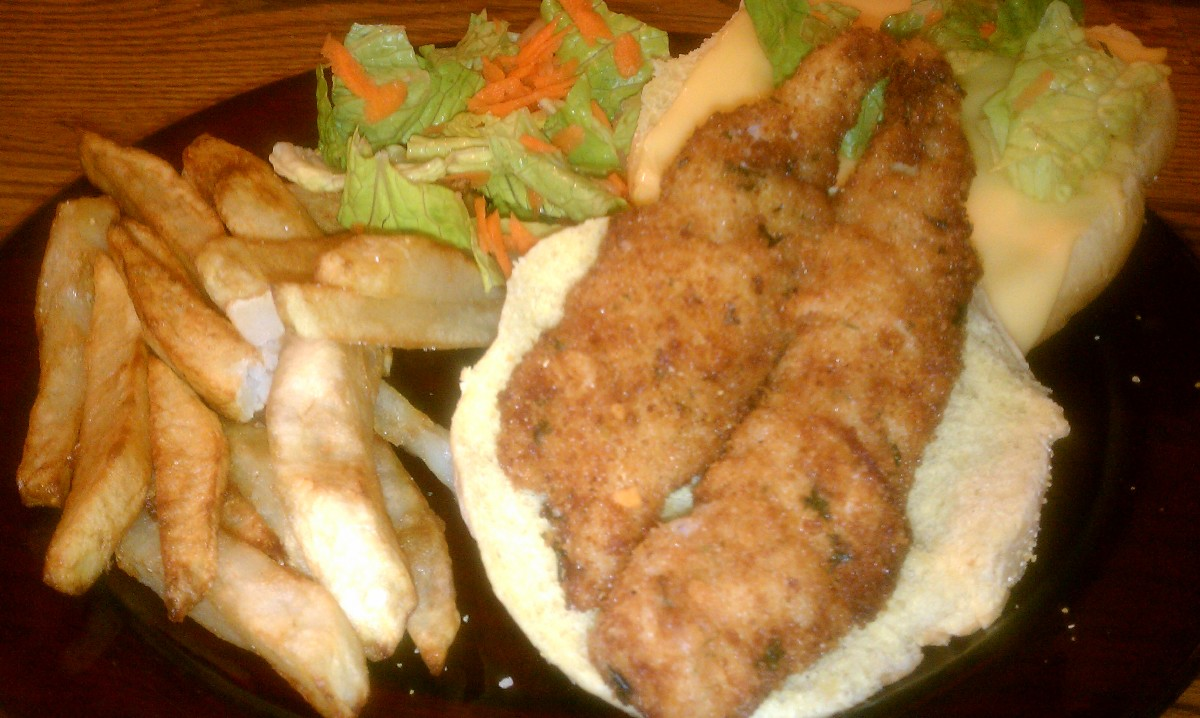 Perch sandwiches served on a bun with American cheese, garden salad and homemade fries!