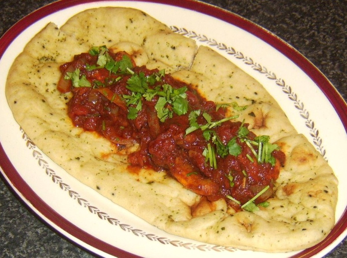 Hot dog with rich and spicy bhuna sauce served in a naan bread