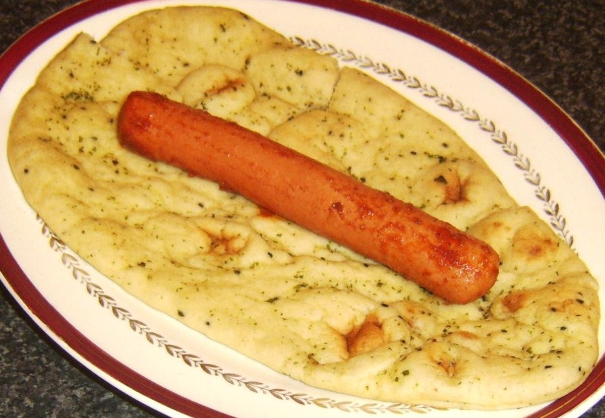 Hot dog is laid on naan bread