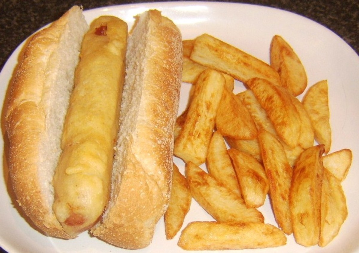 Chips are added to the plate with the sub roll and battered hot dog