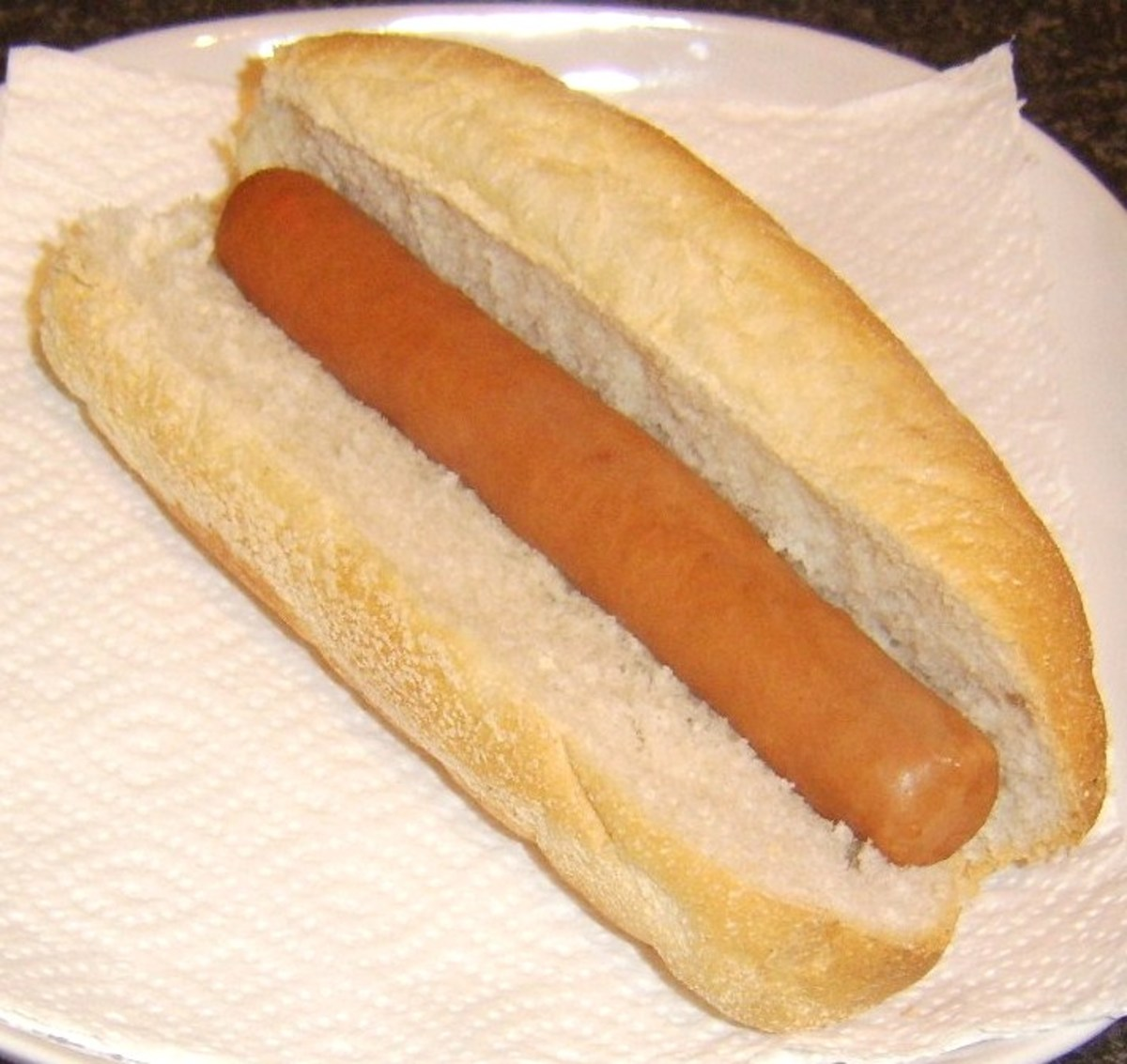 Hot dog is added to sub roll