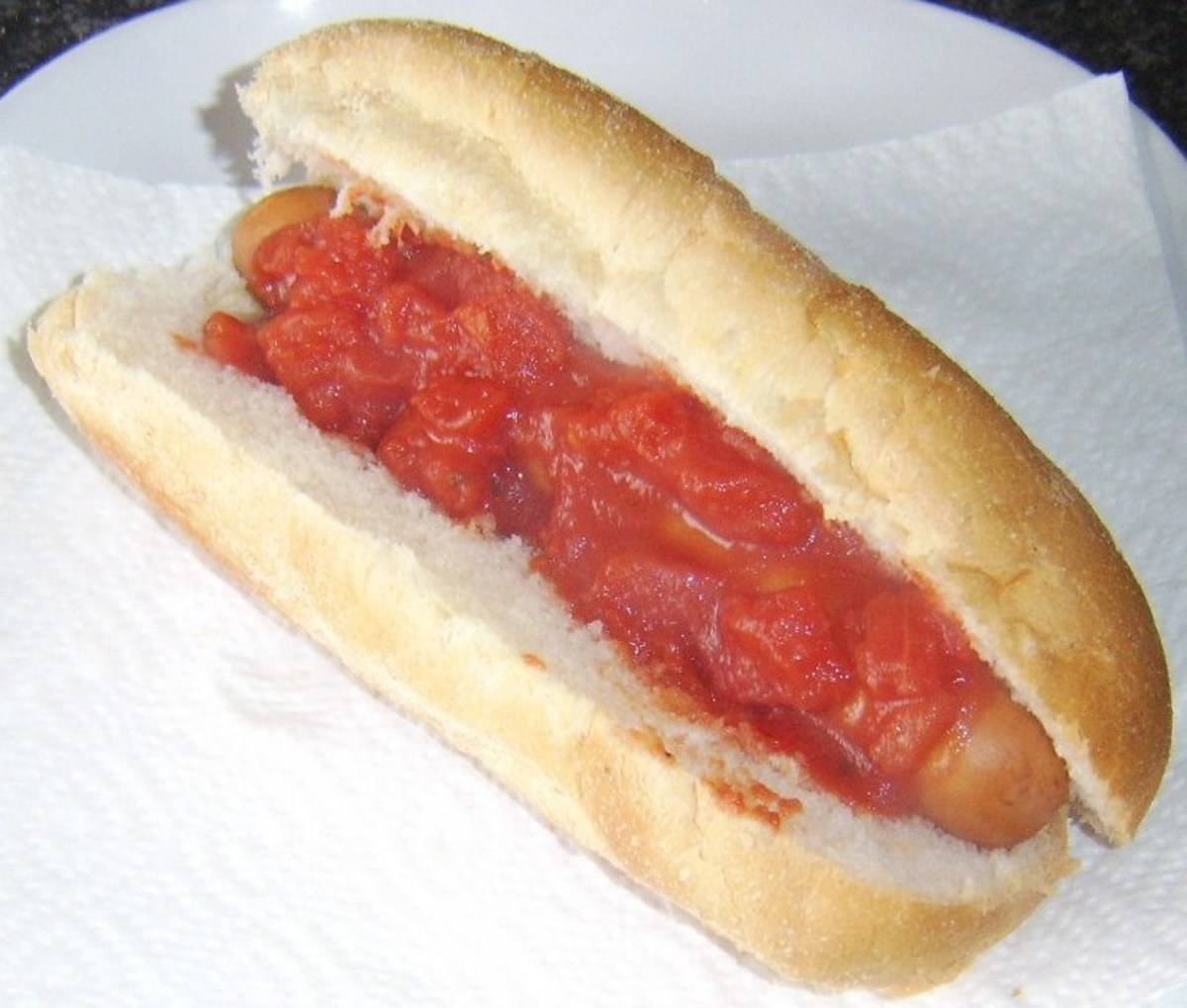 Tomato sauce on hot dog