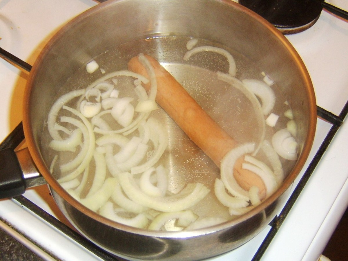 Onion strands soften and separate as hot dog gently heats