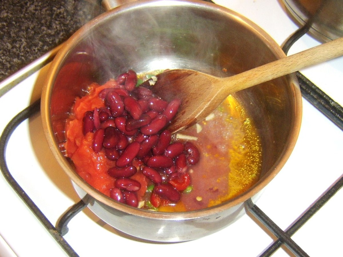 Tomatoes and beans are added to fried off spices