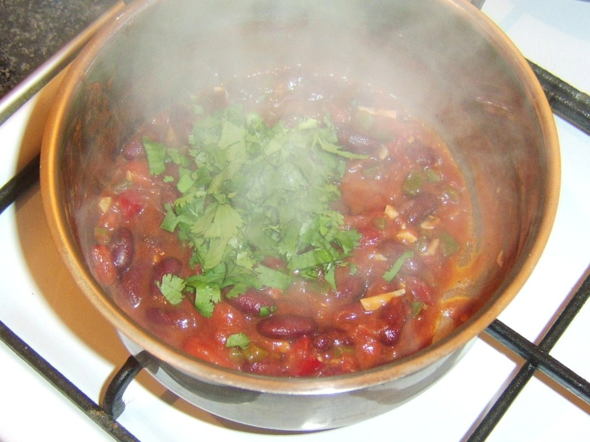 Fresh coriander is added to bean chilli