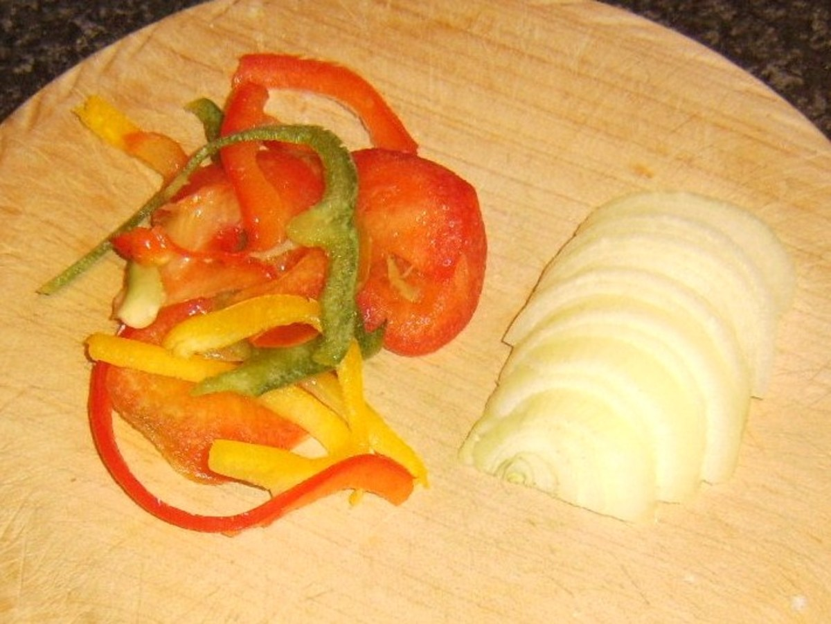 Sliced bell peppers and onion