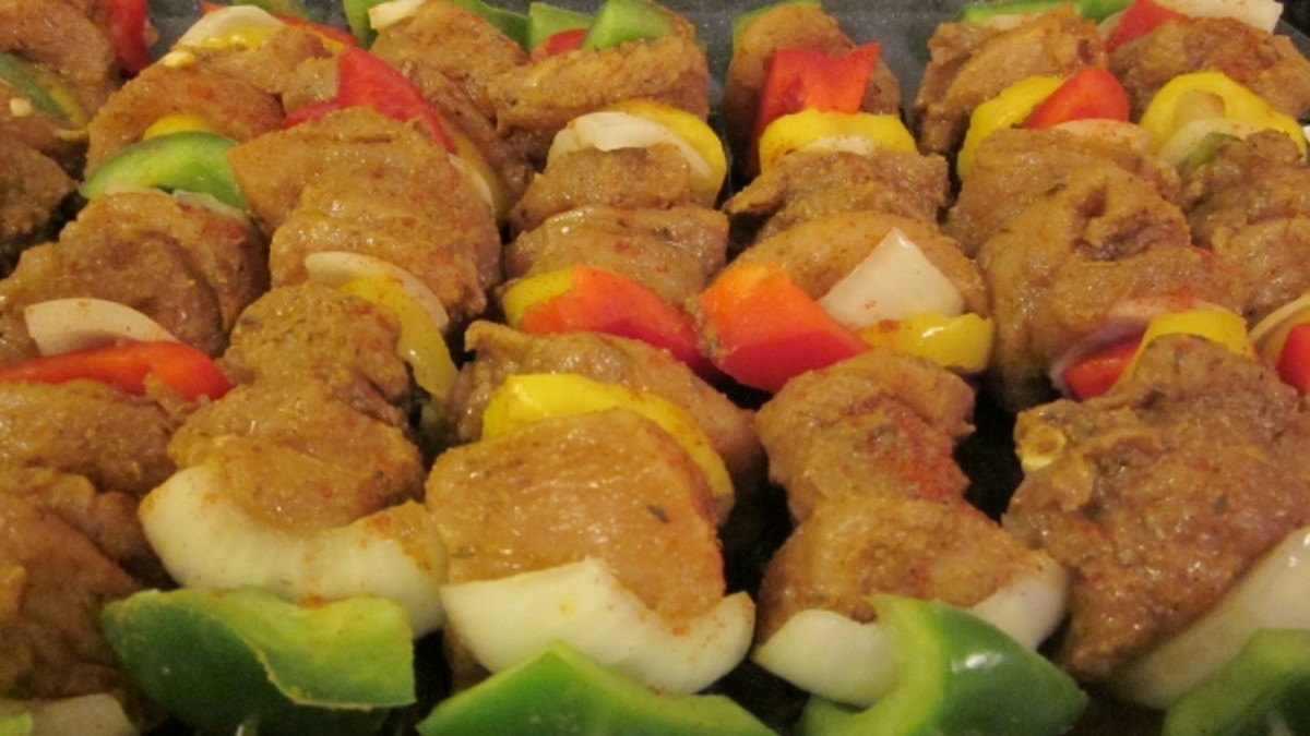 Alternate chicken and vegetables on the skewer with vegetables on each end.