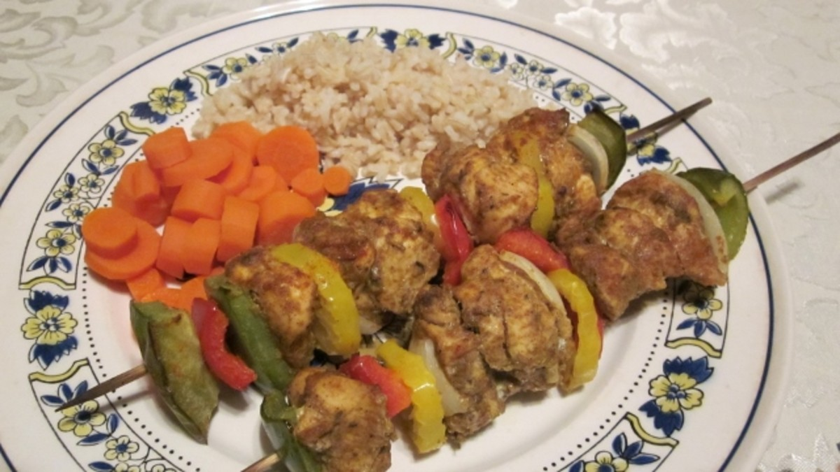 These low-fat, lower sodium kabobs are served with brown rice and freshly cut, boiled carrots for a healthy meal.