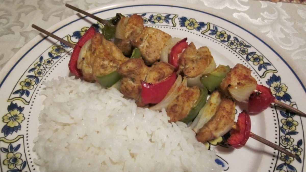 Paired with white rice, curry chicken kabobs make a complete meal.