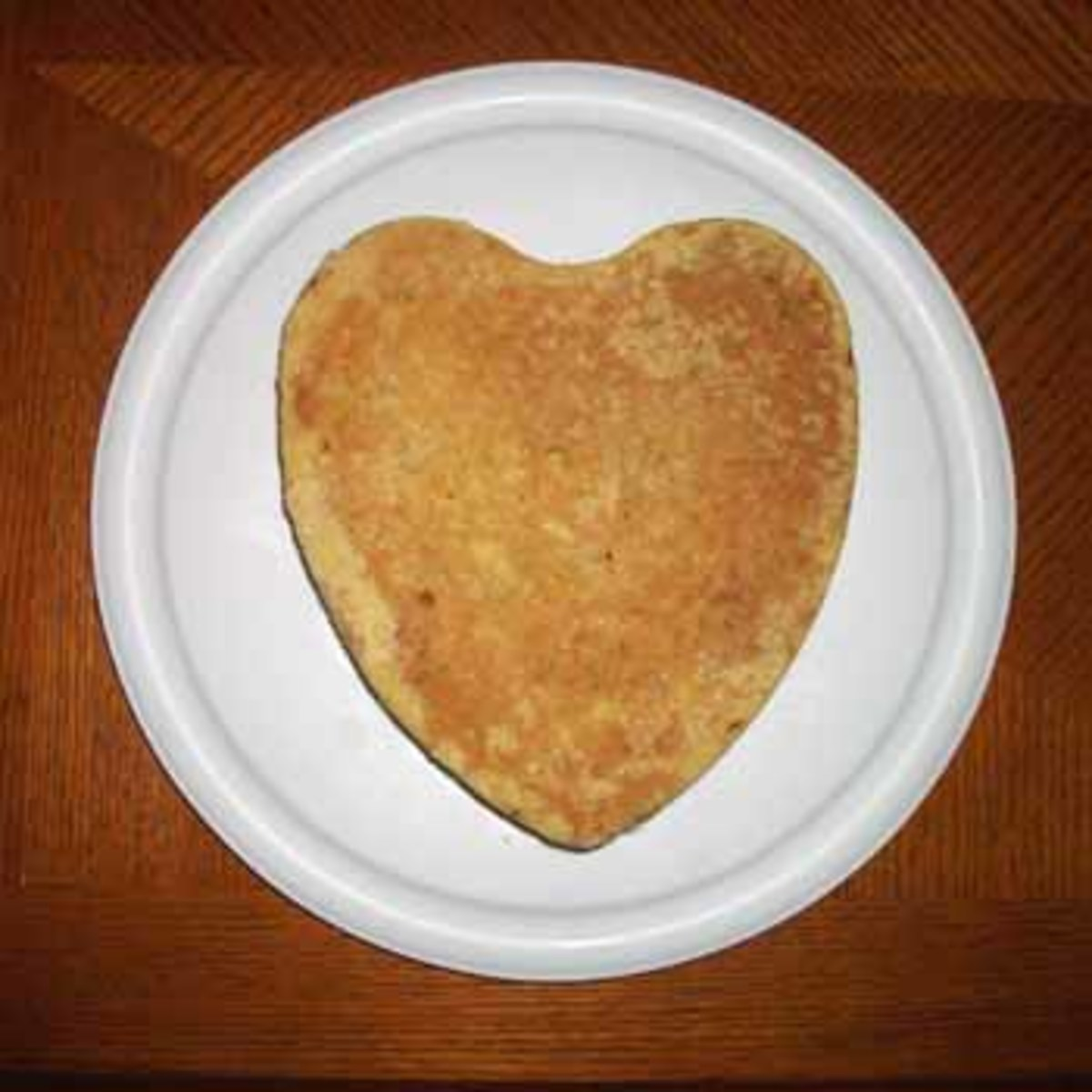 Place the heart cake on top of the edible glue