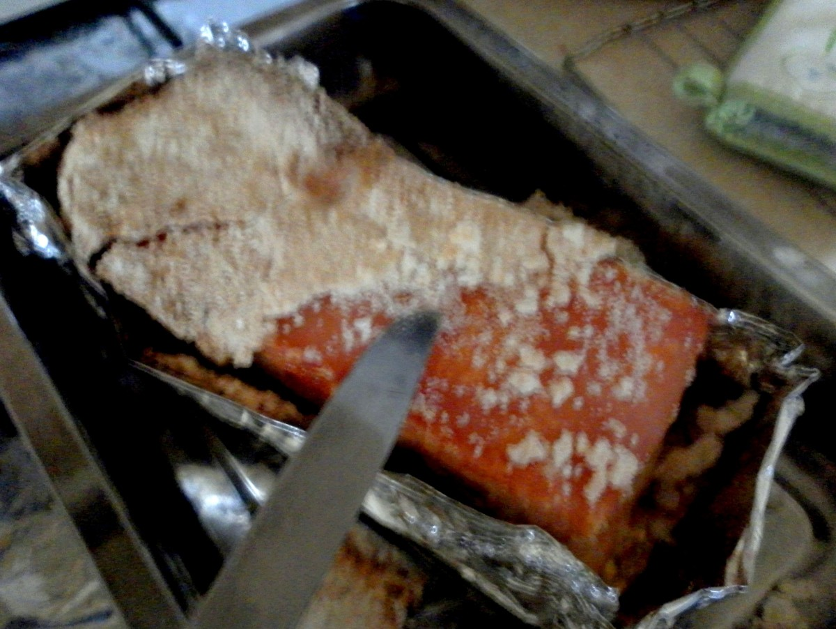 Chisel away the layer of salt with a knife. (Excuse the blurry photo, the photographer was trembling with excitement to see the rind!)