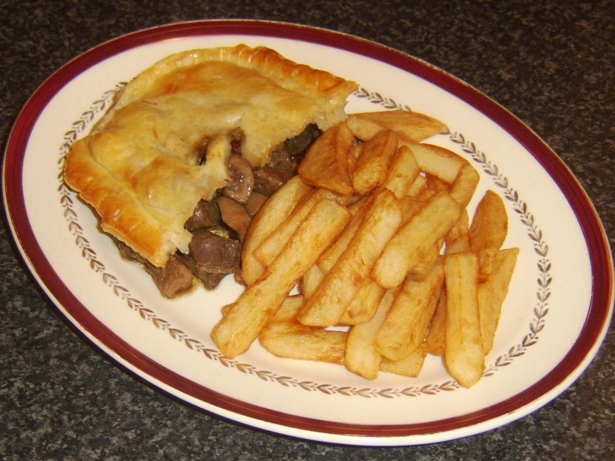 Stewed steak, kidney and liver topped with puff pastry pie and served with homemade chips