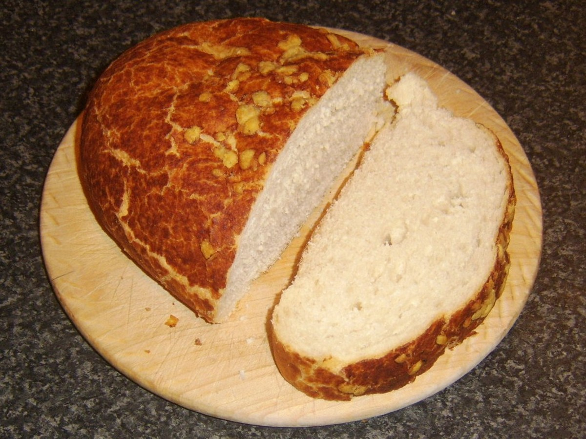 Thick slice of bread is cut for toasting