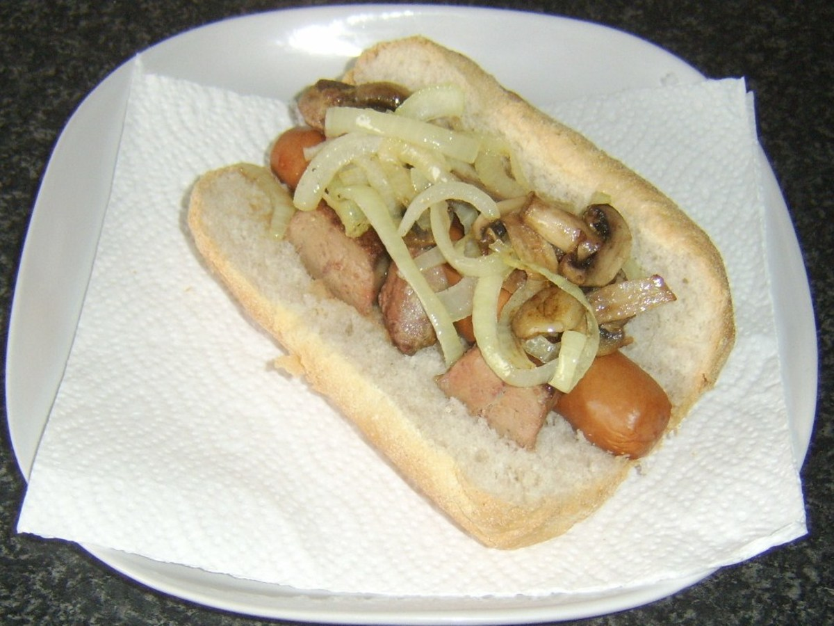 Mushrooms and onion are laid on top of liver and dog