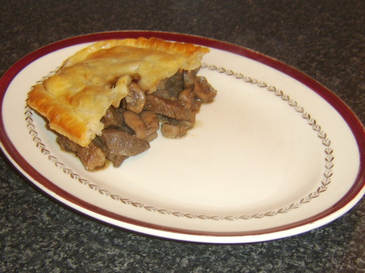 Pastry is laid on top of steak, liver and kidney pie filling