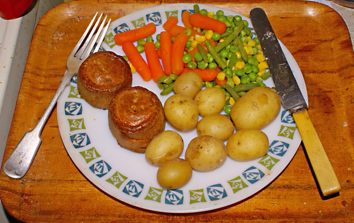 Peas with carrots, corn, potatoes, and Yorkshire pudding; Yorkshire pudding is a baked product made from eggs, flour, and milk