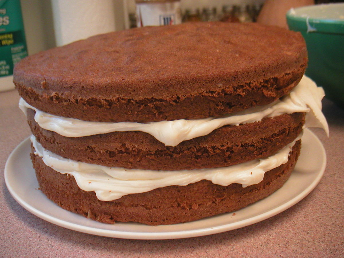 The Leaning Tower of Italian Cream Cake can become a reality if the layers are uneven.