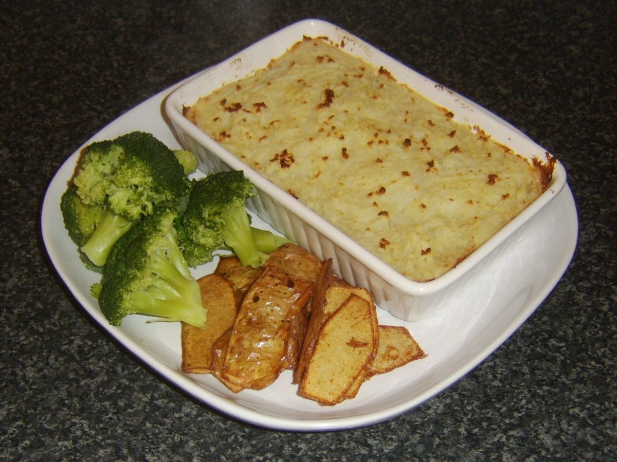Corned beef and cabbage topped with crispy mashed potato with potato skins and broccoli