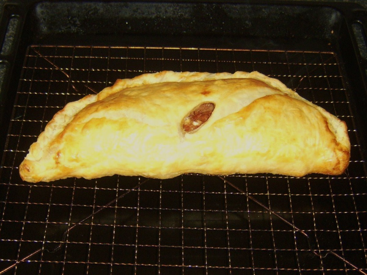 Spicy corned beef and cabbage pasty resting on wire rack