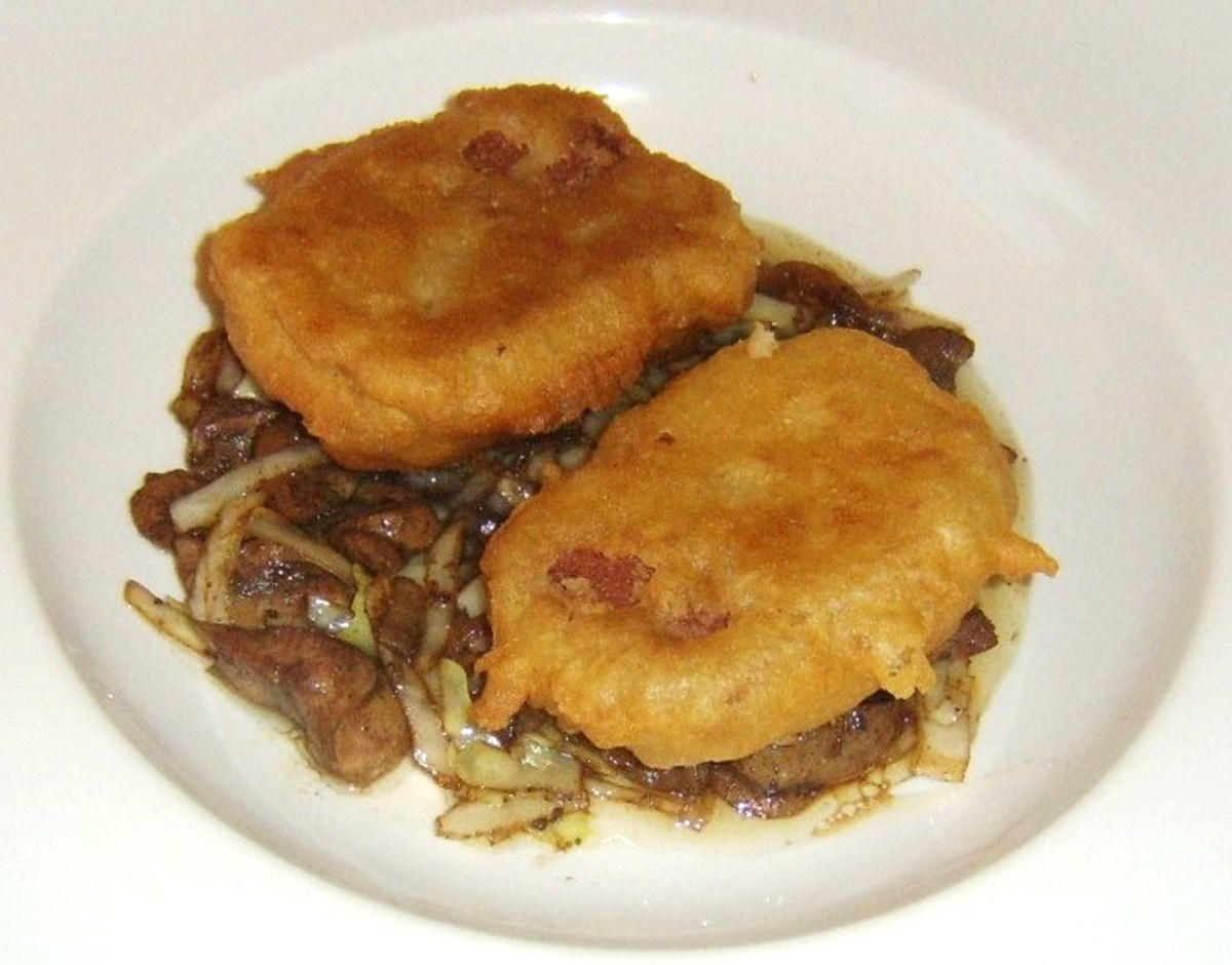 Corned beef fritters are laid on bed of stir fried cabbage and kidneys