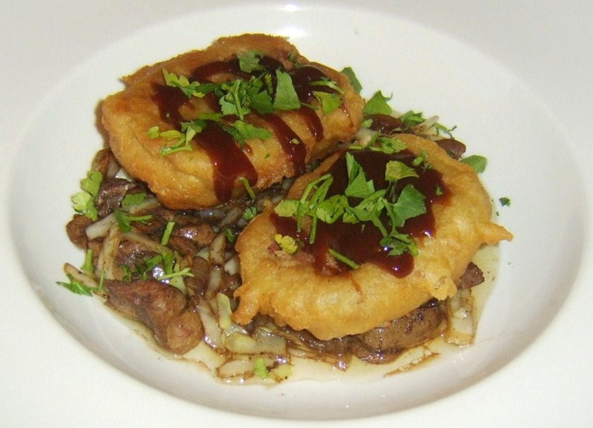 Battered and deep fried slices of corned beef on a bed of stir fried cabbage, onion and ox kidneys