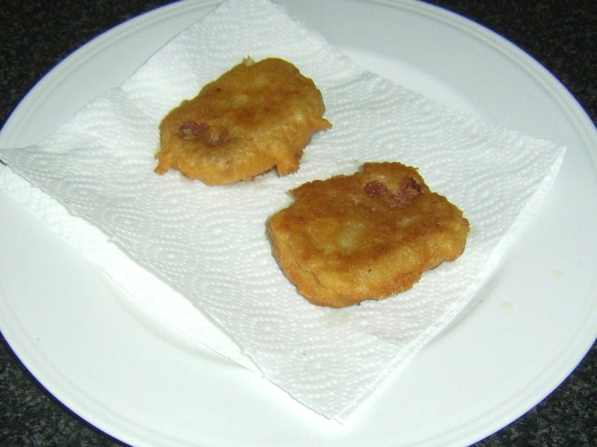 Corned beef fritters are drained on kitchen paper