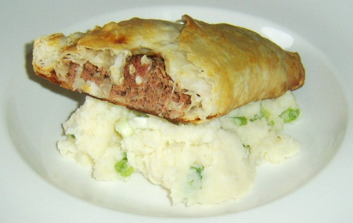 Spiced corned beef and cabbage encased in puff pastry and served on creamy mash with green onions
