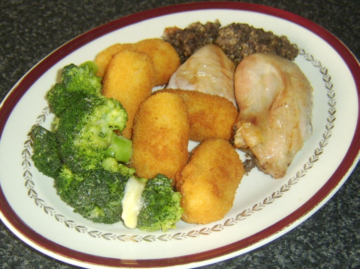 Portions of roast chicken are plated with haggis stuffing, clapshot croquettes and cheesy broccoli
