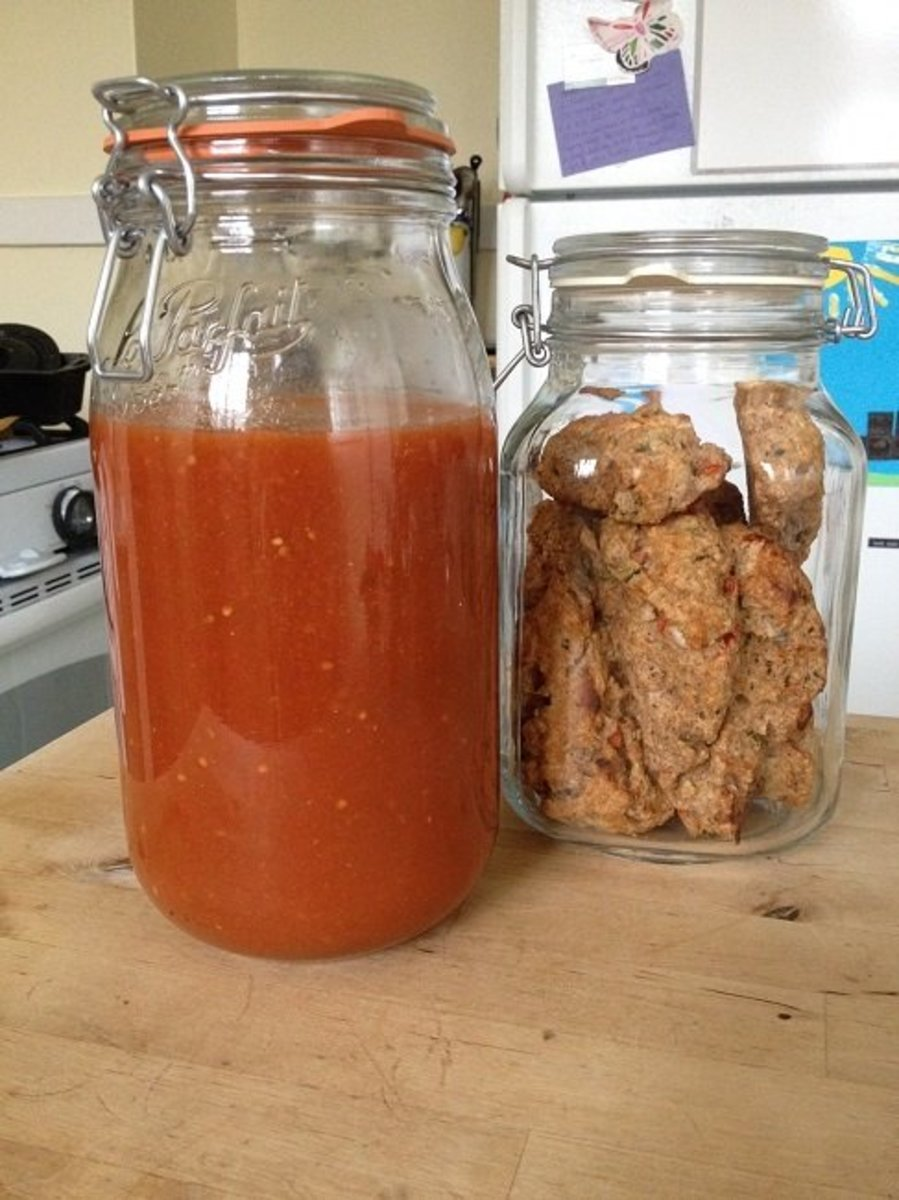 Homemade tomato soup stored in a tall LeParfait jar and homemade whole wheat scones stored in a Fido jar