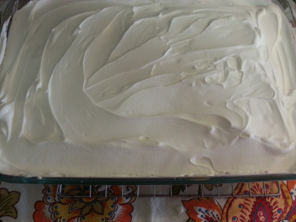 Cake topped with Cool Whip.
