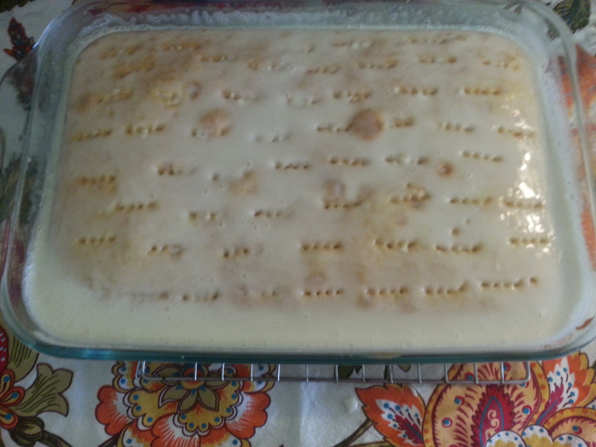 Real Cream of Coconut Milk/Sweetened Condensed Milk mixture poured over warm cake with holes poked into it.
