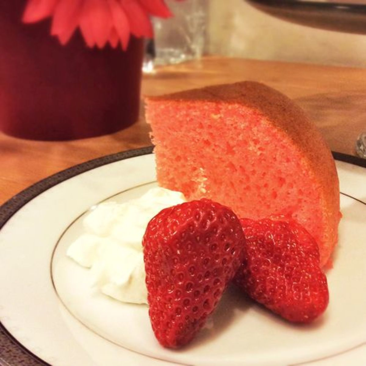 Sliced and placed on a plate with a strawberry and a dollop of whipped cream. Pure decadence!