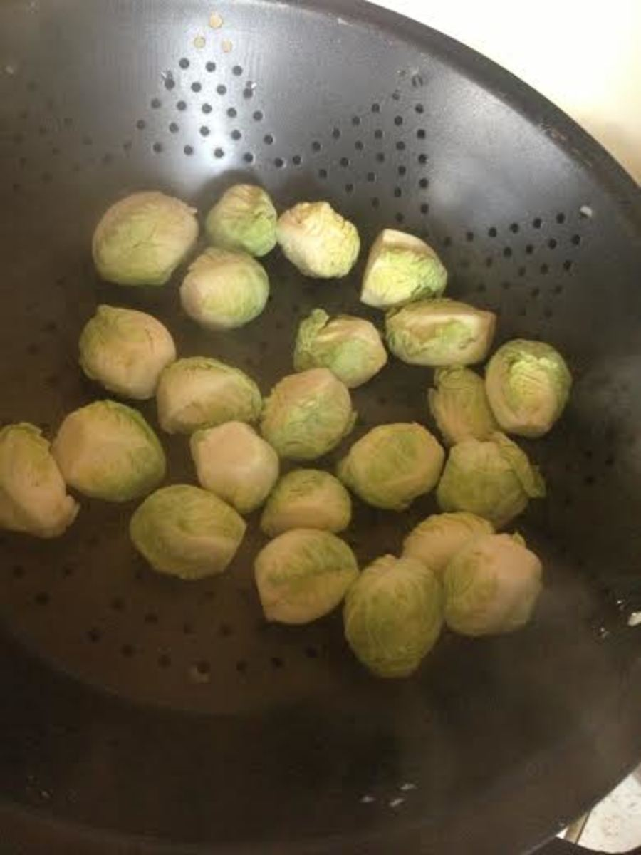 Fill a steamer with a few inches of water and let it come to a boil.  Once the water has started boiling, put the brussels sprout hearts in the top rack of the steamer.