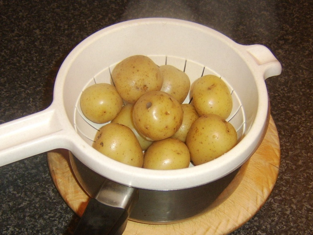 Baby potatoes are boiled in their skins and carefully drained