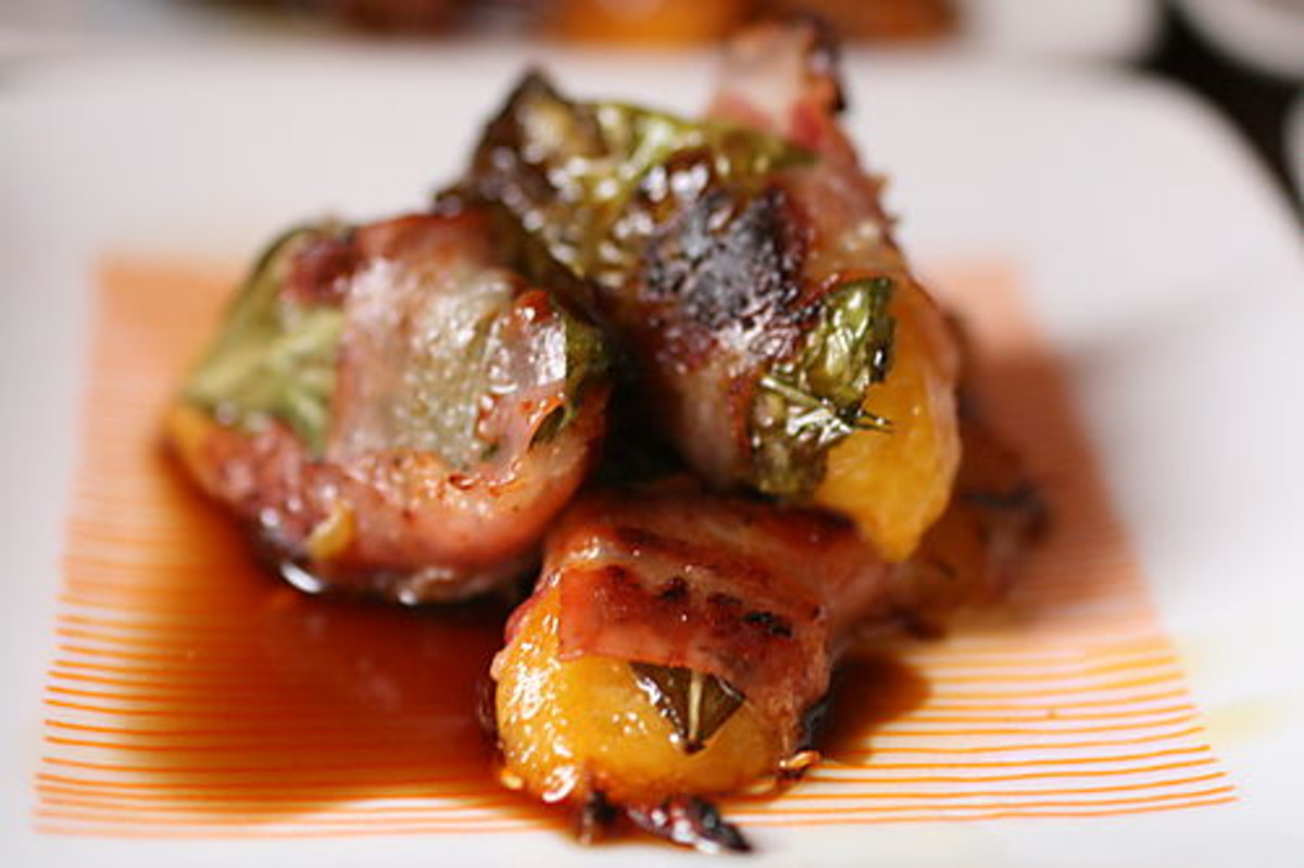 Peach slices and basil leaf wrapped in bacon