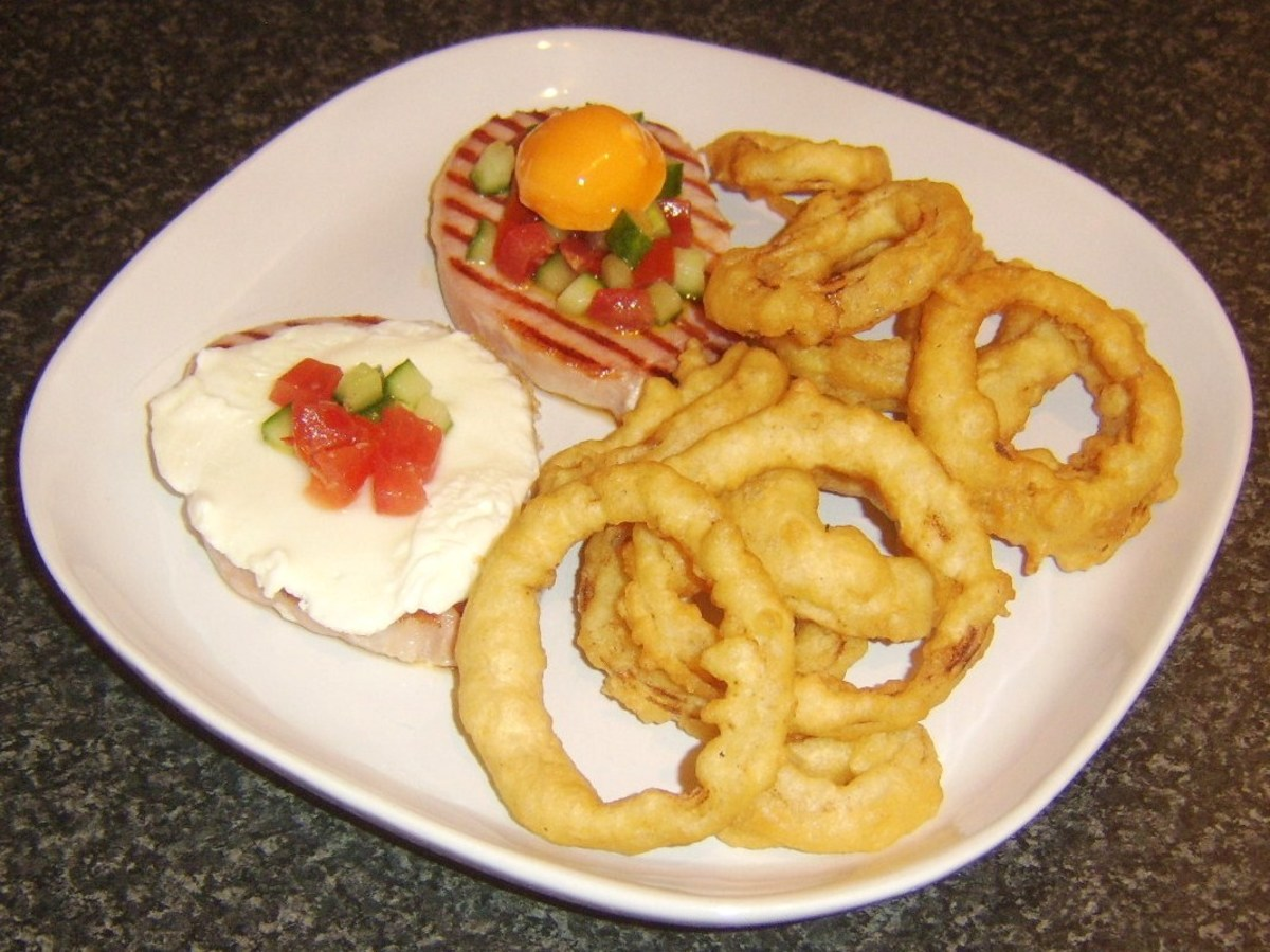 Griddled bacon medallion steaks with salsa, fried egg and onion rings