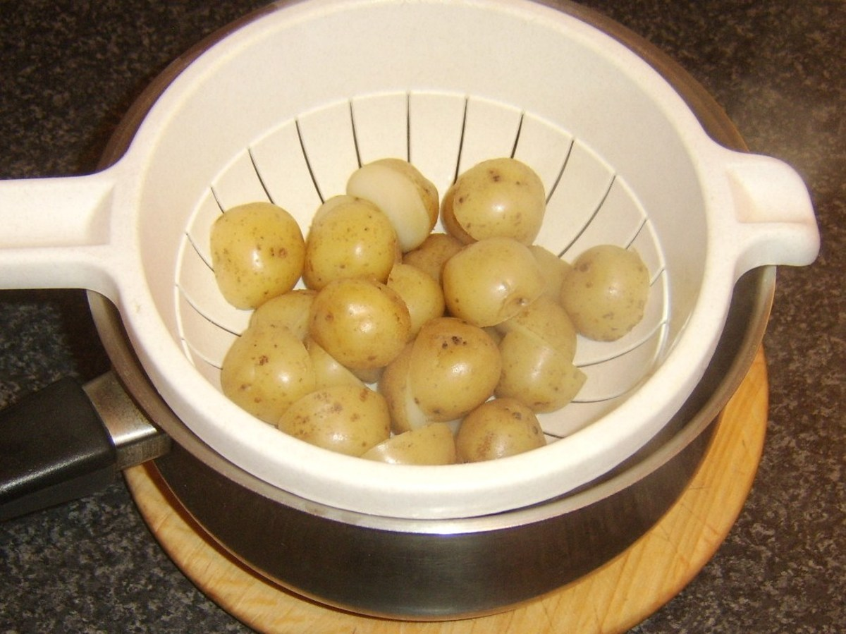 Draining boiled new potato halves
