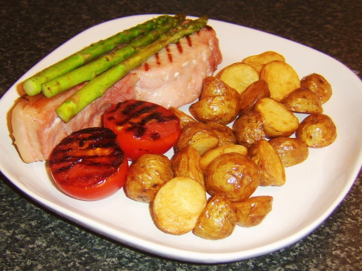 Griddled sweetcure bacon steak served with griddled asparagus and tomato with mini pan roasted potatoes
