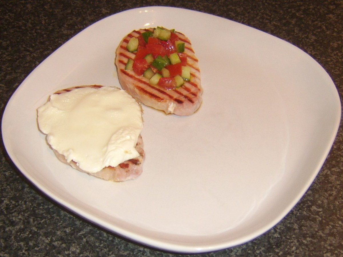 Egg white and salsa are laid/spread on bacon steaks