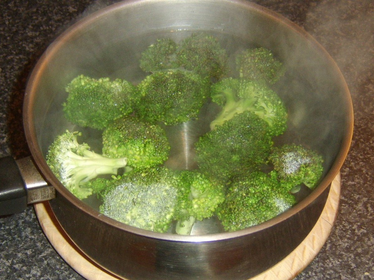 Boiling water and salt added to broccoli florets