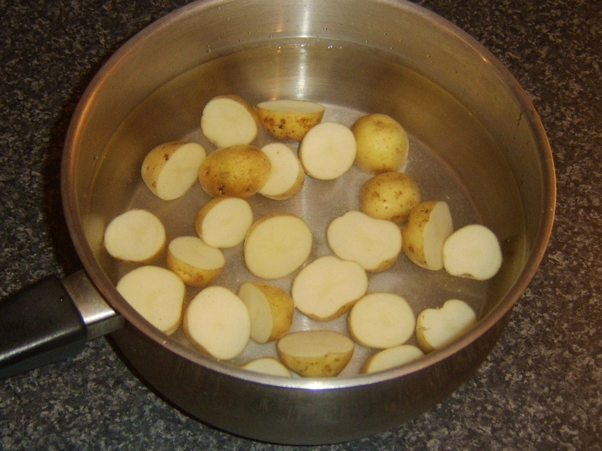 New potato halves ready to be boiled as first stage of cooking