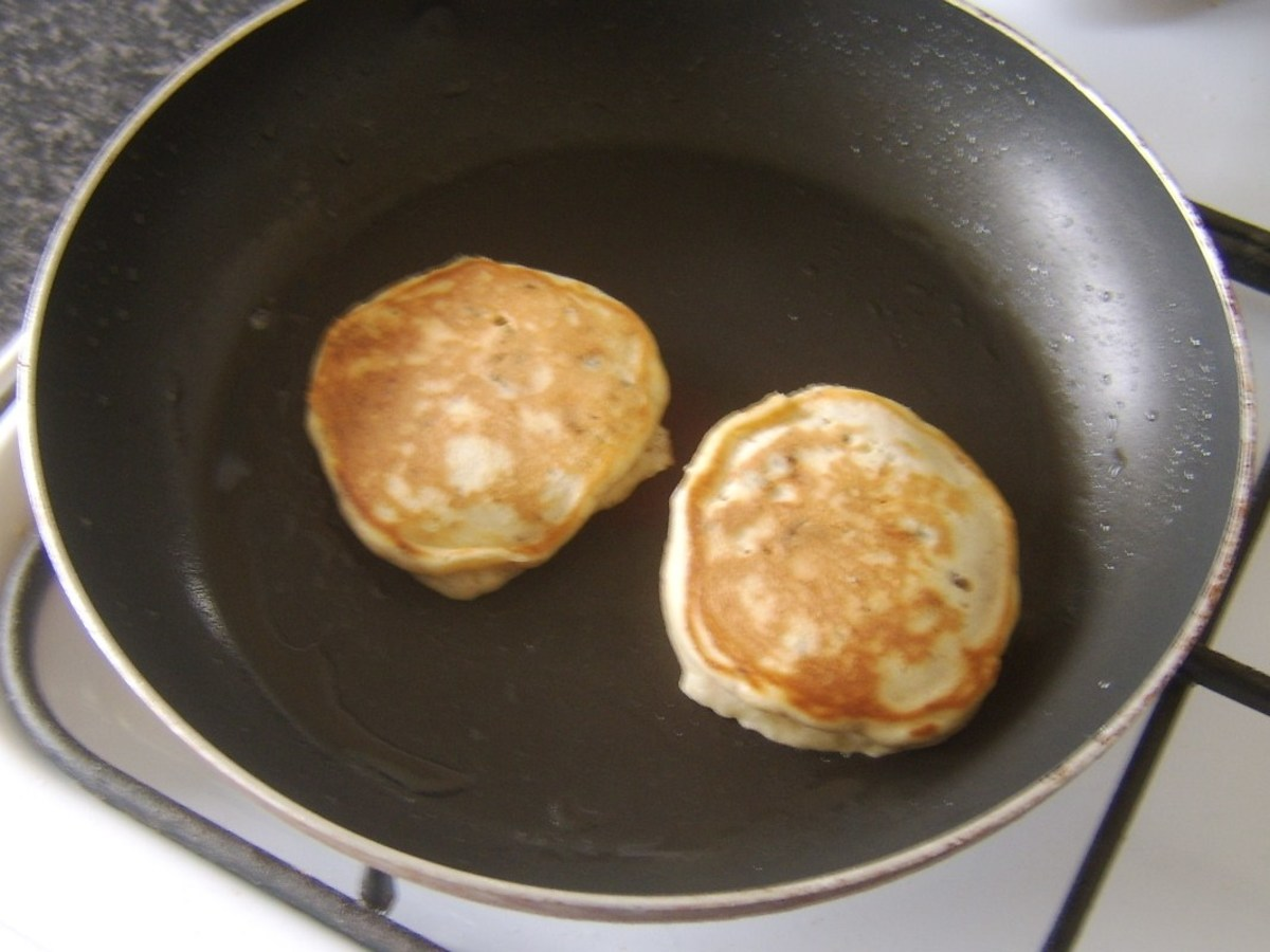 Christmas pudding pancakes are turned