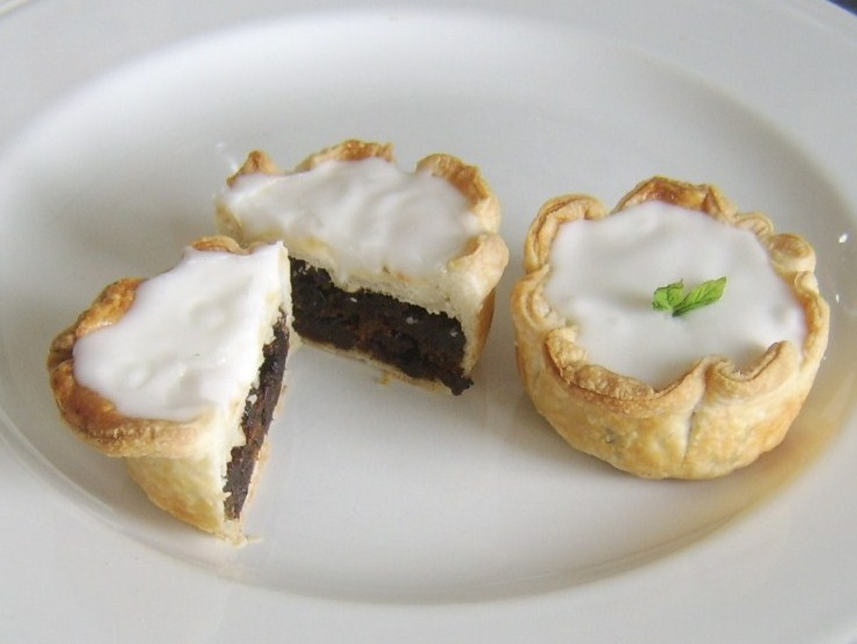 Christmas pudding filled puff pastry fies are topped with icing