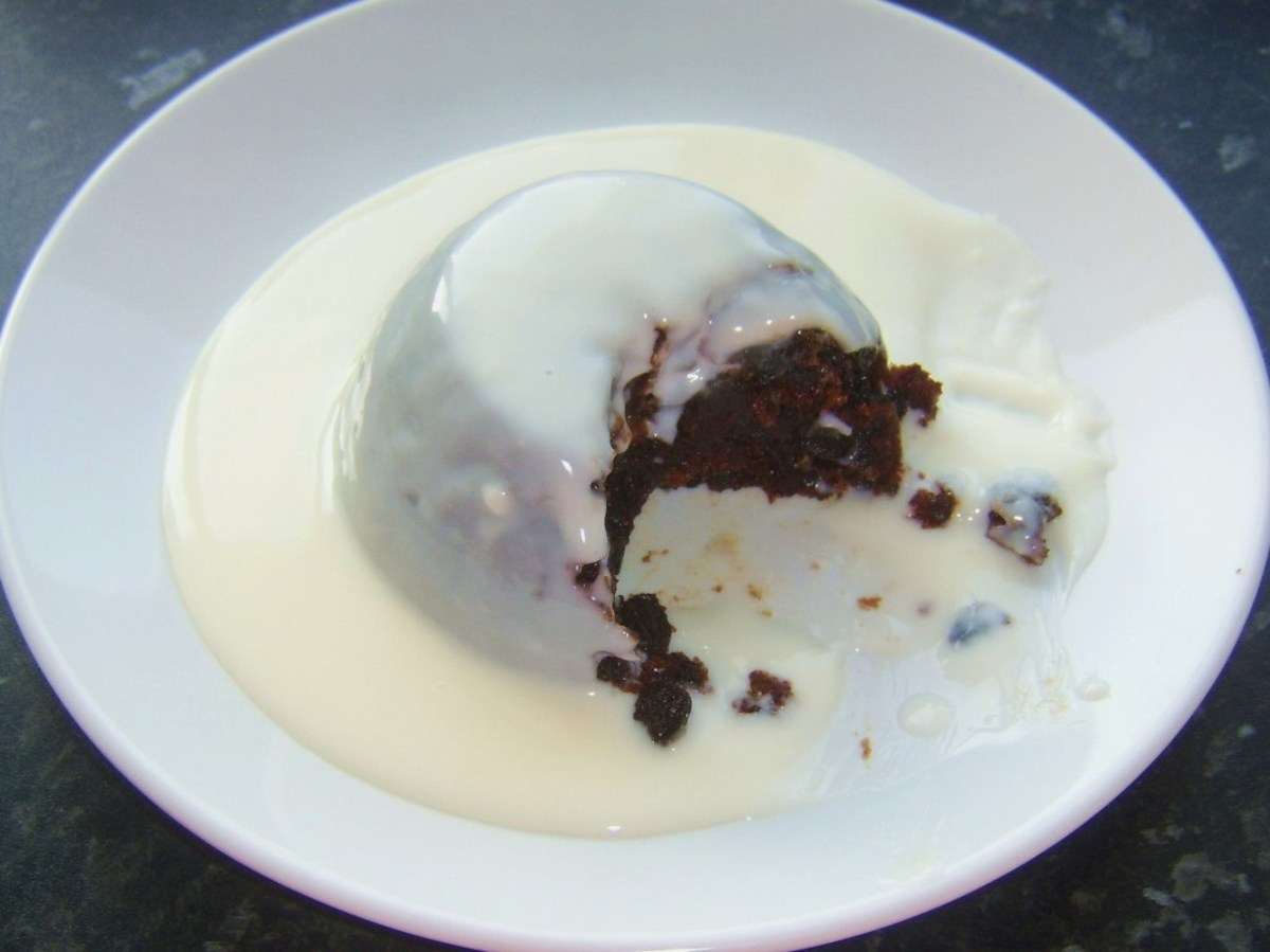 Christmas pudding served simply with rum sauce