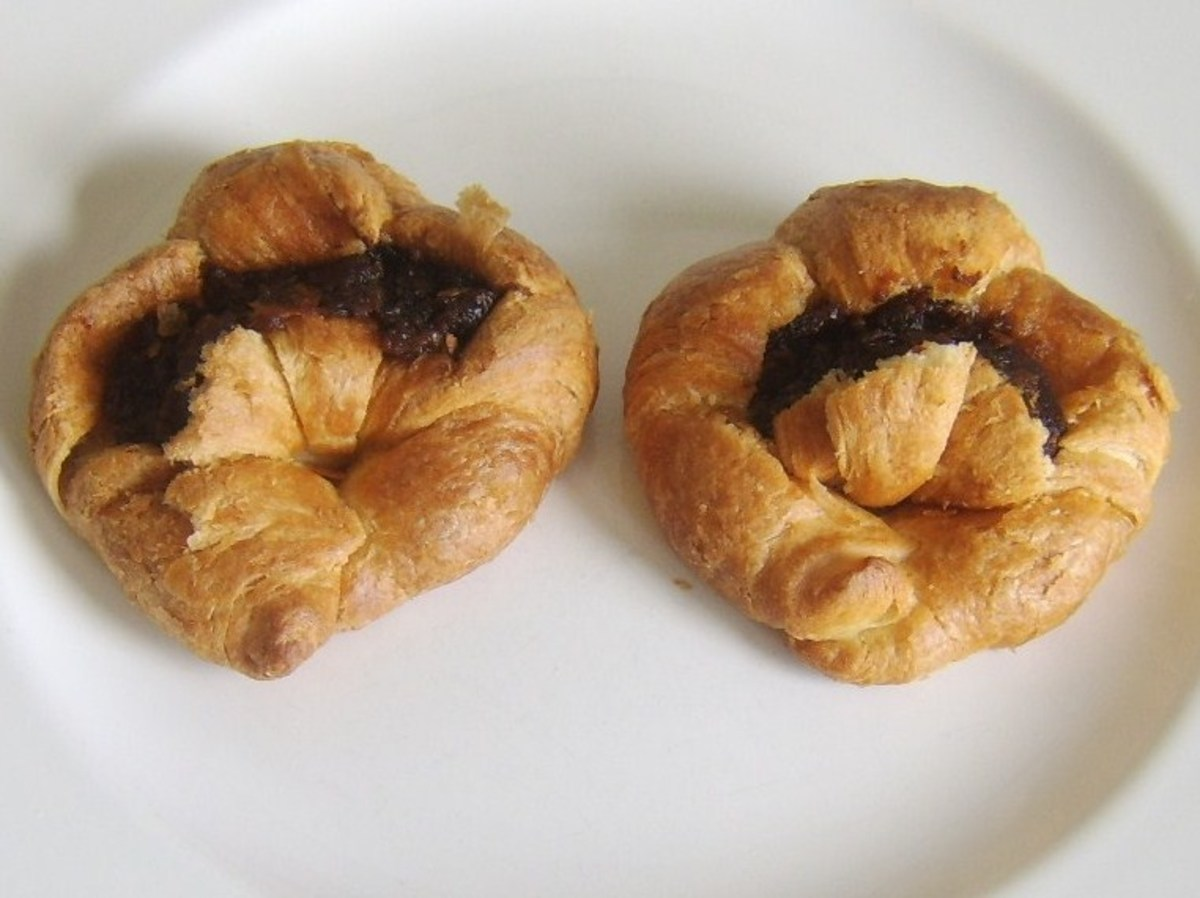 Croissants are slit open, buttered and stuffed with Christmas pudding